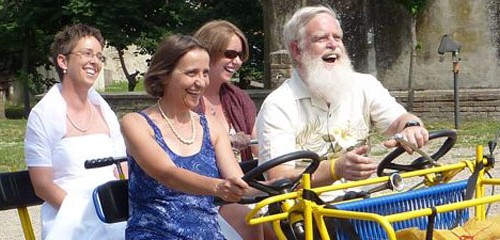 Monica Price bicycling to her wedding