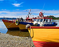 Colorful boats on Chiloe Island
