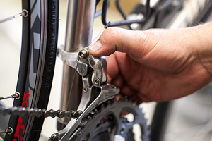 Adjusting a front derailleur. Photo by John Giebler