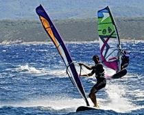 Friends windsurfing in Bol, Croatia