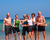 A hearty group in Sardinia hit the sea directly after the ride. Photo by ExperiencePlus! traveler Julie Sklom