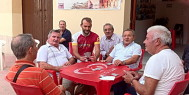 ExperiencePlus! tour leader Enrico Dal Monte stops to join a card game in Sicily.