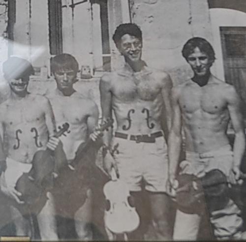 Historic photo men with violin tatoo