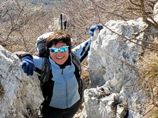 ExperiencePlus! tour leader Michela Bresciani climbing in the mountains above Lake Garda