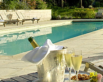 Treat yourself with wine poolside.